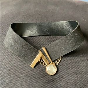 Black choker with gold accent